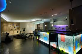 large modern man cave where the neon base lit bar is the highlight the long