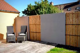 to give this concrete fence a more decorative and natural appearance the customer has chosen to fill the wall recesses with individual bamboo sticks