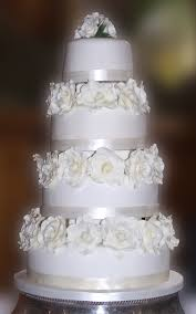 8 White Tiered Wedding Cakes Photo 4 Tier Wedding Cake With Roses