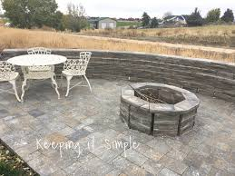 here is a closer view of that actually fire pit they used the same pavers as the wall for the fire pit they also thin set the fire pit too to keep it