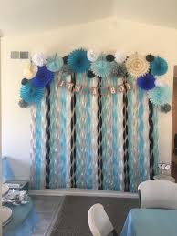 blue and white paper decorations with its a boy garland