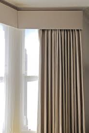 grey curtains with white voile and pelmit -