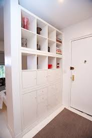 To divide your entryway off from main room. Entryway with DIY Room Divider  from an IKEA Expedit Hack