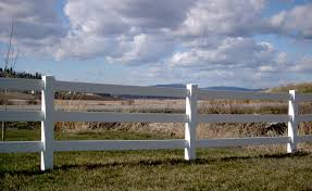 white fence post. 3 Rail White Vinyl With Mt Spokane In The Background Installed By Valley Fence Post