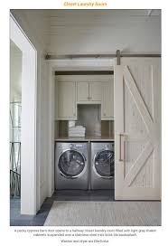 beautiful pact laundry room with pecky cypress barn door
