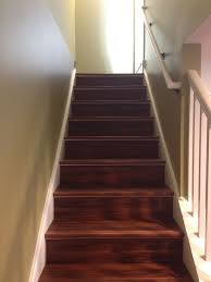 easy quick installed vinyl planks directly on top of the old plywood basement stairs and capped it off with matching vinyl stair nose trim