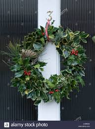 England UK Christmas wreath on a front door Stock Photo, Royalty ...