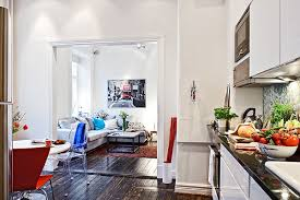 Small Swedish Apartment Securing the Inhabitant's Every Need Shop this  look: couch, coffee table, art.