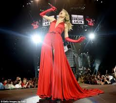 scarlet woman the country pop star positively dazzled in her flowing red satin ensemble