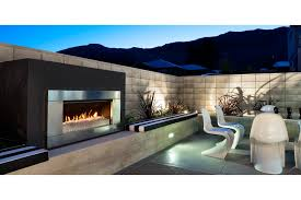 outdoor gas or wood fireplaces supplier escea escea ef5000 gas heater stainless steel ferro fascia and white pebbles fuel bed
