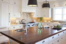 dark grey cabinets with butcher block countertops dark wood white kitchen island with dark wood transitional