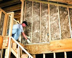 insulation in wall 2x4 r value a man installing fiberglass cellulose vs thickness insulation for walls r
