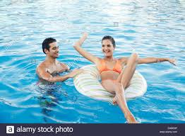 swimming pool with friends. Delighful Swimming Friends Relaxing In A Swimming Pool For Swimming Pool With M
