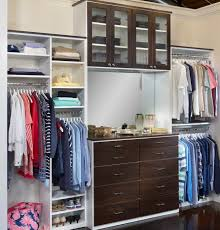 fully adjule saint louis closet co floor based closet system with glass doors and drawers add a mirror and vanity shelf to turn your closet into