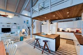 Blue Cottage Kitchen With Wood Counter Island At Beach House With Loft