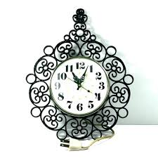 chaney wall clocks wall clock wrought iron wall clock electric wall clock black wrought iron by chaney wall clocks