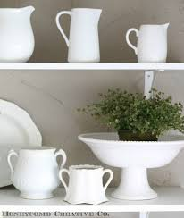 I'm not sure if I'll ever tire of white kitchenware...it's so versatile.  You don't have to do an all-white look like this. You could use it as a  backdrop ...