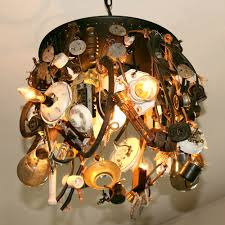 recycled ceiling lamp features antique porcelain switches plugs sockets filament bulbs insulators