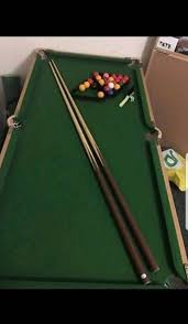 5ft slate fold away pool table with and 2 cuesin wirral merseyside