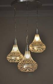 morrocan style lighting. E Kenoz - Modern Moroccan Handing Lamps, $250.00 (http://www.ekenoz.com/ Moroccan-lighting/moroccan-pendant-lights/modern-moroccan-handing-lamps/) Morrocan Style Lighting
