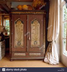 antique armoire furniture. Painted Antique Armoire Beside Window With Heavy Cream Curtain In Country Living Room Furniture I