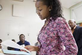 persuasive speech topics for students african american student reading from paper in classroom