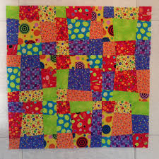 Stitch a Quick and Easy Crazy Nine Patch Quilt Pattern & Arranging the Crazy Nine Patch Blocks Adamdwight.com