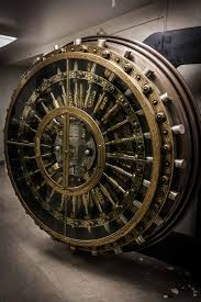the locking mechanisms of an old bank vault door 1365 x 2048