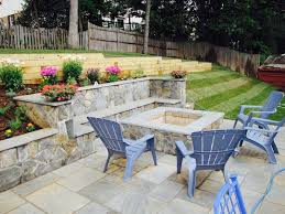 stone patio installation: dimensional flagstone patio with maryland blend stone walls and fire pit