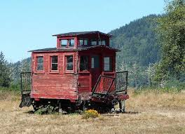 Old Wooden Caboose, possibly a narrow gauge....looks like a toy ...