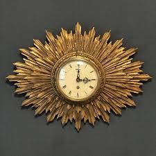 wall clocks sunburst wall clock 22877c8e 3d2b 44fa a3b3 2f4c500ca7f0 jpeg