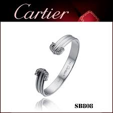 c de cartier cuff bracelet in white gold with paved diamonds