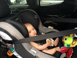 baby securely fastened into maxi cosi moda with favourite toys check maxi cosi moda car seat review
