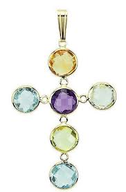 14k yellow gold gemstone cross pendant dainty 14k yellow gold connections make the fancy cut gemstones really shine genuine gemstones are hand cut and