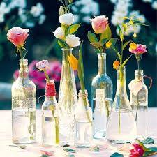 View in gallery Clear glass bottles filled with flowers