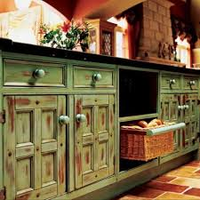 outstanding green distressed cabinets finished with black countertop as well as door and drawers storage in rustic kitchen ideas furnishing decors