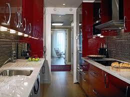 modern small narrow red kitchen design with metal backsplash and under wall cabinet lights cabinet lighting backsplash home