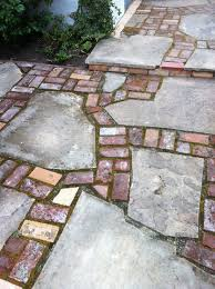 flagstone patio installation from start to finish. reclaimed brick and flagstone patio installation from start to finish
