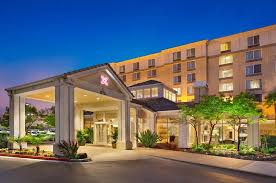 the building where the hotel is located the lobby or reception area at hilton garden inn san francisco