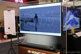 lg wallpaper tv. really stands for wallpaper, and you can\u0027t put this tv on a stand: it has to be mounted wall, it\u0027s done so with magnetic mounting system. lg wallpaper tv
