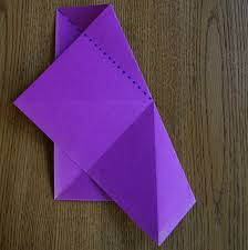 to further divide the paper into 16 wedges turn the paper over painted side down so this second set of 8 folds are valleys to the first 8 fold s