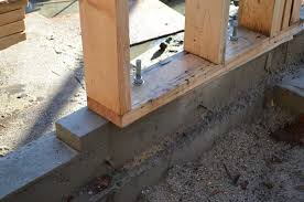wood sill plate over foam gasket and concrete