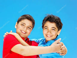 happy cute boys over blue sky stock