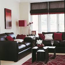 Red and chocolate living room Subtle matching of wall decor to several  accesories, looks classy