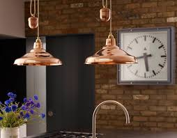 heritage british manufacturer davey lighting has launched its first adjule pendant light the rise fall school light is the latest addition to the