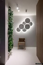 interior lighting designer. a great light installation instead of the picture on wall with dream about kenzo by olga akulova design interior lighting designer