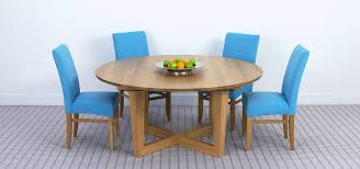 round extendable dining table in solid oak and x shaped base brunel round