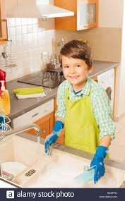 boys washing dishes. Fine Boys Young Smiling Little Boy Washing Dishes In The Kitchen With A Lot Of Soap  And Boys Washing Dishes