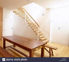 floor seating dining table. Minimalist Dining Room With Wood Floor, Floating Staircase, And Wooden Table Bench Seating. Floor Seating N