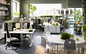 office dining table. An Open-plan Office With White Desks, Drawer Units On Castors In Different Heights Dining Table